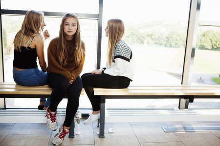 fed up: Isolated teenage schoolgirl in corridor LANG_EVOIMAGES