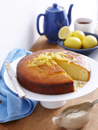 Still life of lemon yogurt cake with lemon rind garnish