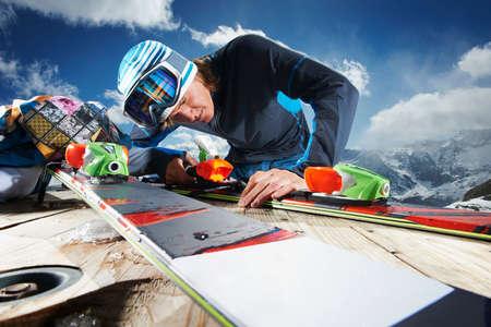 fed up: Male skier examining skis