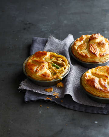 Still life of three chicken pies made with puff pastry LANG_EVOIMAGES
