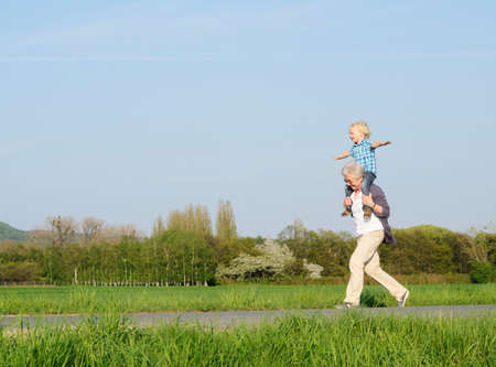 2 way: Grandmother carrying boy on shoulders