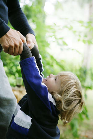 Man pulling at childs hands