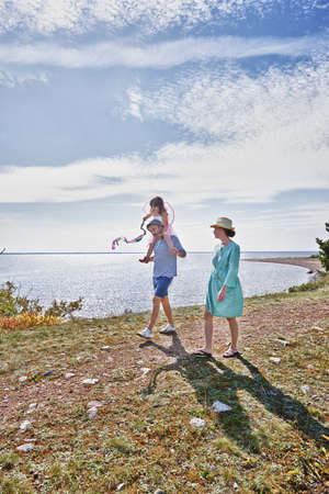 Family walking by sea,Eggergrund,Sweden LANG_EVOIMAGES