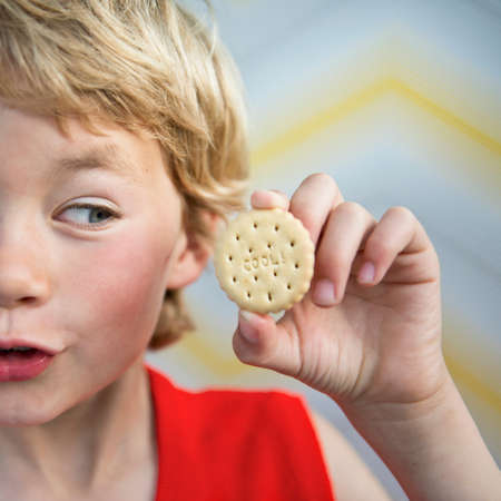 top 7: Boy holding cool biscuit LANG_EVOIMAGES