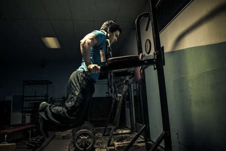 Weightlifter in dark gym,bench press LANG_EVOIMAGES