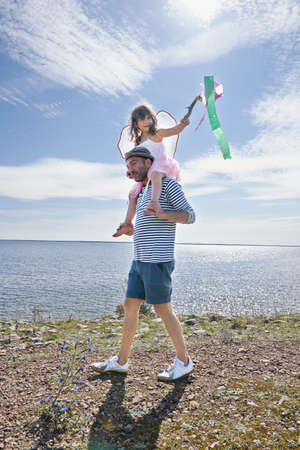 Father and daughter walking by sea,Eggergrund,Sweden LANG_EVOIMAGES