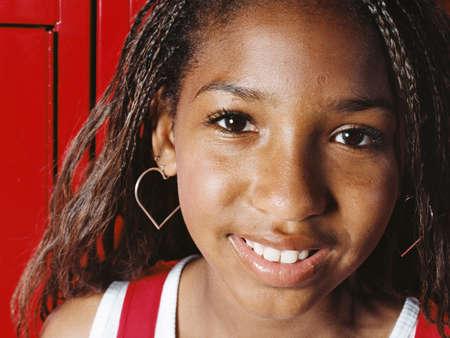 Girl smiling in school locker room,close up