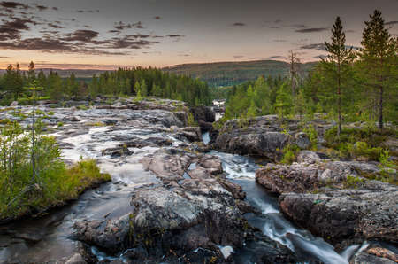 River flowing through gorge,Storforsen,Lapland,Sweden LANG_EVOIMAGES