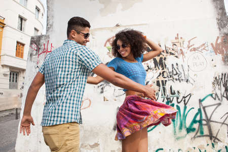 Young couple dancing in street LANG_EVOIMAGES