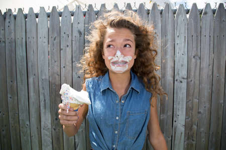 untidiness: Teenage girl with ice cream on face