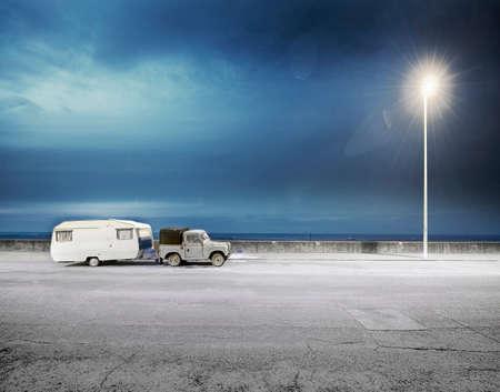 street lamp: Truck towing caravan on road