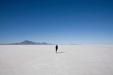 desolacion: Woman standing on the Bonneville Salt Flats,Tooele County,Utah,USA