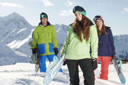 Friends holding snowboards,Kuhtai,Austria LANG_EVOIMAGES