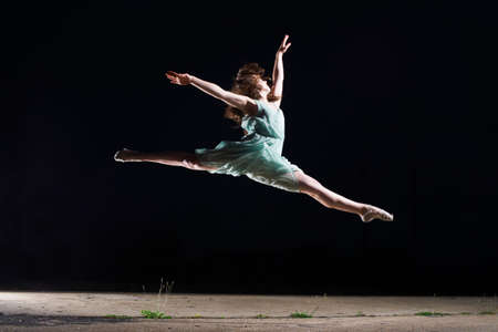 Ballet dancer leaping mid air