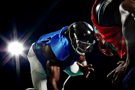 athletic wear: Close up of two american footballers playing head to head