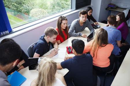 north western european descent: Teenage schoolchildren working together with digital tablet