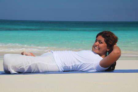 Young woman on beach practicing yoga,Paradise Island,Nassau,Bahamas