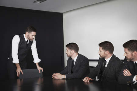 manipulated : alter: Businessmen in meeting,multiple image