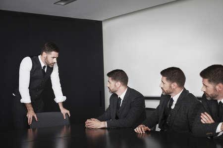 subservience: Businessmen in meeting,multiple image