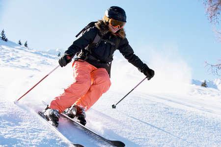 Female skiing downhill