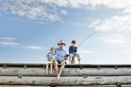Boys with grandfather fishing,Utvalnas,Sweden