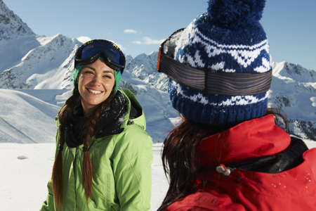 Two women wearing knit hats in snow,Kuhtai,Austria LANG_EVOIMAGES