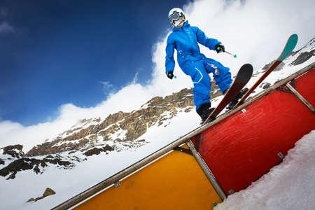 Male skier standing on ramp start