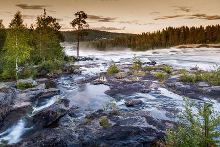 View of river flowing over rocks,Storforsen,Lapland,Sweden LANG_EVOIMAGES