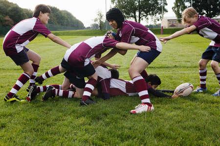 low self esteem: Teenage schoolboy rugby team practicing