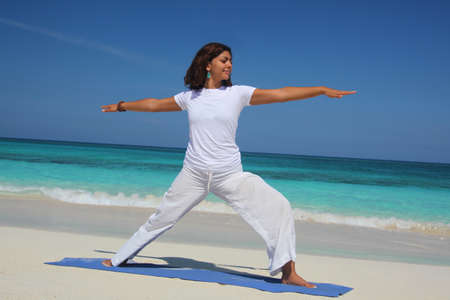 Young woman doing yoga warrior pose,Paradise Island,Nassau,Bahamas