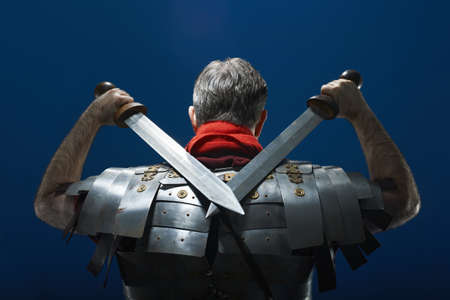30 years old man: Rear view studio portrait of roman soldier with swords LANG_EVOIMAGES