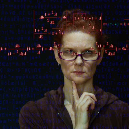Woman focusing on mathematical equation