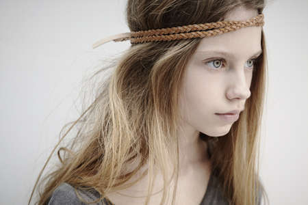 alice band: Portrait of girl wearing leather braid around head