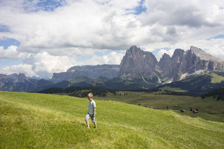 sleeve: Boy walking up hill,Alto Alige,South Tyrol,Italy LANG_EVOIMAGES