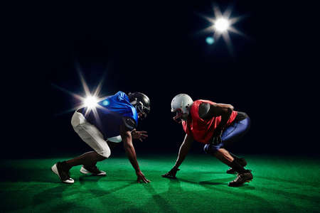 Two american footballers crouching LANG_EVOIMAGES