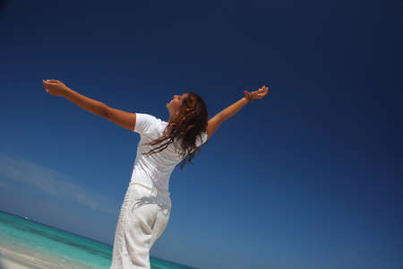 Young woman with arms outstretched on beach,Paradise Island,Nassau,Bahamas