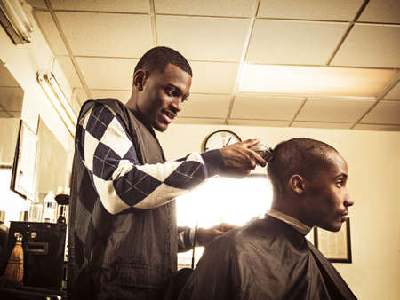 reminisce: Barber in traditional barber shop shaving mans head