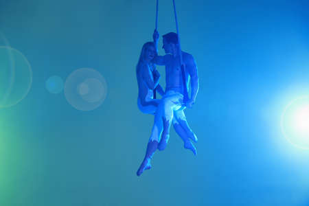 Couple sitting on trapeze