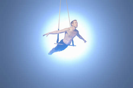 Man balancing on trapeze