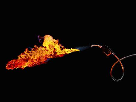 ablaze: Gas pump handle in flames