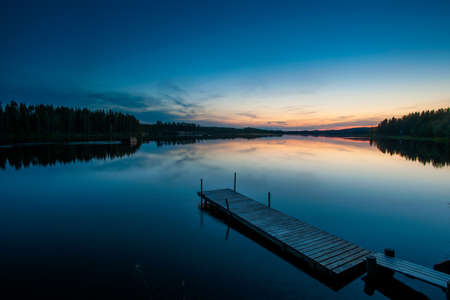 northern light: Lake and wooden pier at dawn,Skelleftea,Lapland,Sweden LANG_EVOIMAGES