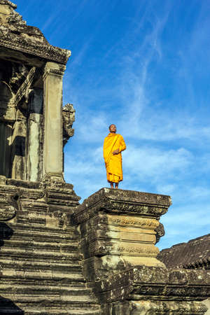 in low spirits: Young Buddhist monk standing outside temple in Angkor Wat,Siem Reap,Cambodia
