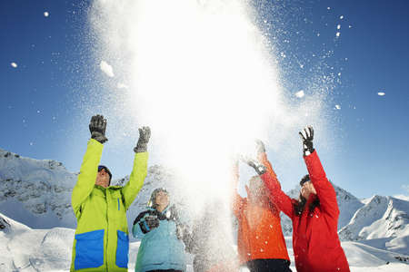 Friends throwing snow mid air,Kuhtai,Austria LANG_EVOIMAGES
