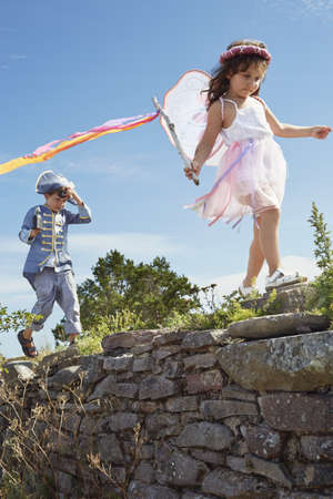 woman hanging toy: Boy and girl dressed as pirate and fairy,Eggergrund,Sweden