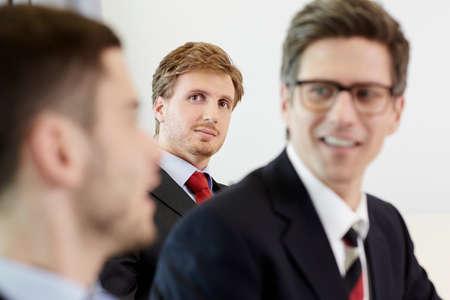 Headshot of businessmen smiling LANG_EVOIMAGES
