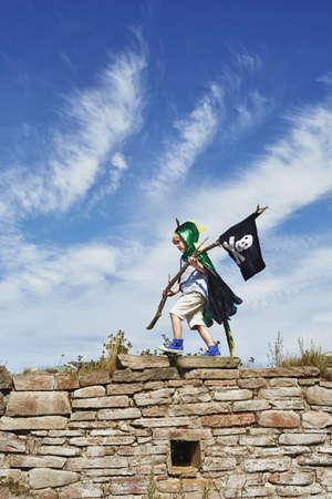 Boy carrying pirate flag,Eggergrund,Sweden