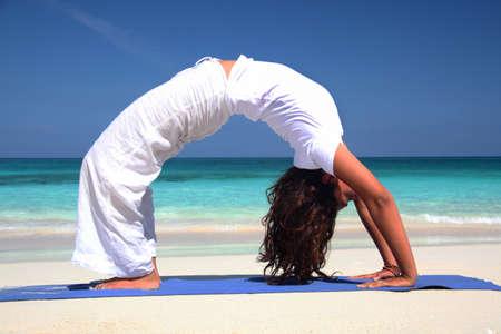 Young woman practicing yoga on beach,Paradise Island,Nassau,Bahamas