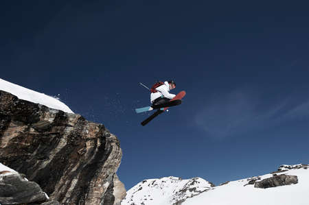southern european descent: Low angle view of male skier mid air LANG_EVOIMAGES