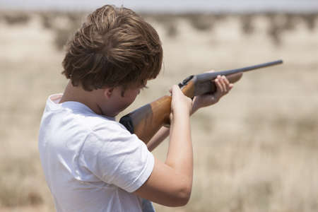 Boy with rifle,Texas,USA