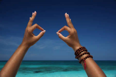 Close up of hands making gesture on beach,Paradise Island,Nassau,Bahamas LANG_EVOIMAGES